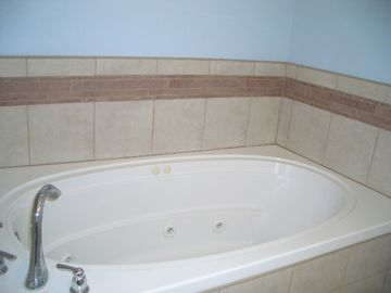 Jetted tub in the main master bedroom.