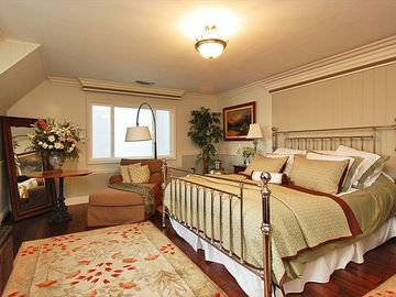 Master Bedroom upstairs with King bed. All have amazing views of the lake
