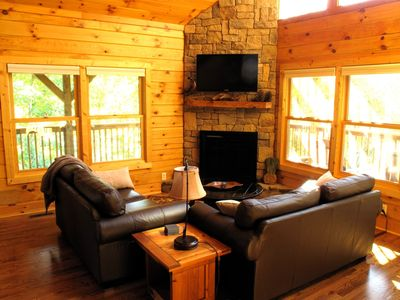 Greatroom has gas fireplace, 40-inch TV and surrounded by decks.