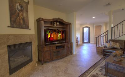 Cave Creek condo rental - View of TV in living room towards front door.
