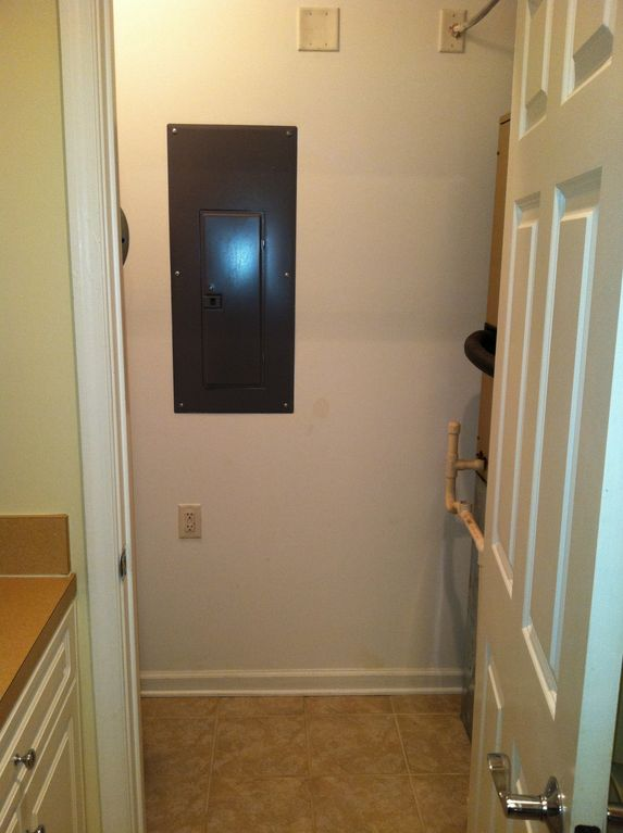 This is a spacious closet right off the kitchen