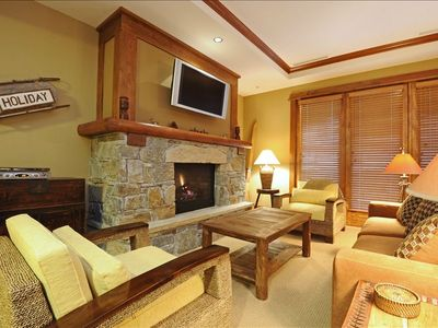 Cozy living area with gas fireplace and flat screen TV - Opens to balcony