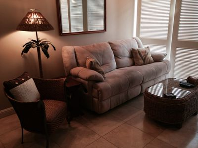 Living has reclining couch, 2 comfy chairs &  coffee table stores board games