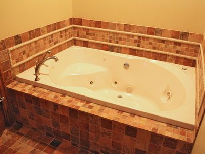 Mid level master bath that also has a whirlpool tub in addition to the shower