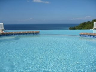 Aguadilla condo photo - Infinity Pool with appearance of overflow into Aguadilla Bay