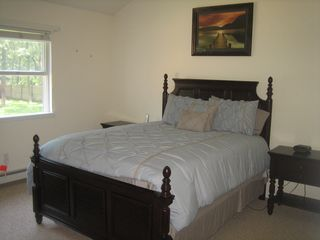 Hampton Bays house photo - Master Bedroom w/ bathroom, dresser w/mirror and large closet.
