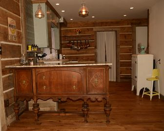 The bar between the dining and kitchen areas