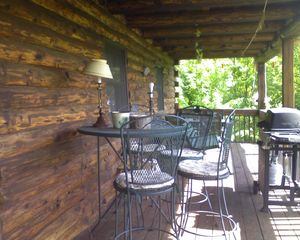 Newfound Lake cabin photo - Porch view taken from the lounging chairs.