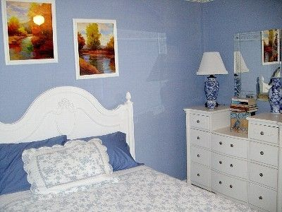 "The ""Dreamweaver Lane"" Blue Bedroom is cottage style with Queen Bed"