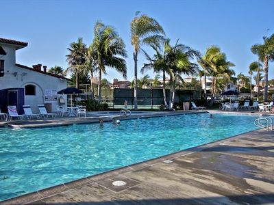 Heated community pool, jacuzzi, and tennis courts