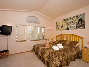 The spacious master bedroom with Cal-king bed lets you spread out in style.