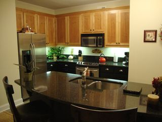 Hiawassee condo photo - Fully Equipped Kitchen with easy serving to Dining Rm