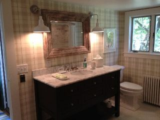 Woodstock farmhouse photo - First floor bath/master bath. White marble, wood tub, mahogany vanity