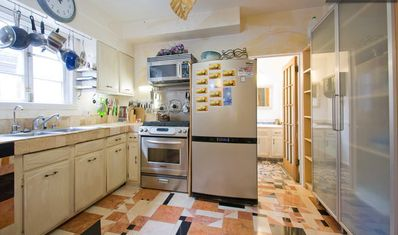 Large Eat in Kitchen with hand cut Marble Tile Floor.