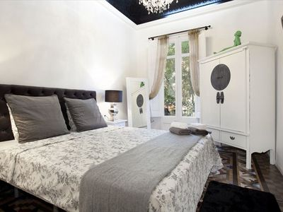 Dreta de l'Eixample apartment rental - Bedroom #1 with tall decorated ceiling and chandelier
