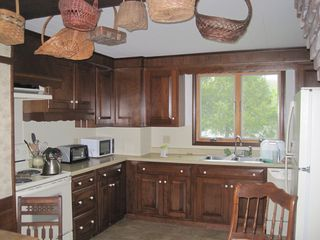 Westport Island house photo - A fully equipped kitchen with cherry cabinets.