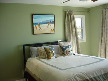 This guest bedroom has a sliding door to the upstairs ocean view deck