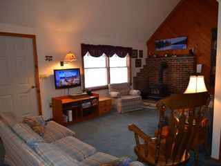 Conway house photo - Living room with flat screen TV, DVD/VHS player and wood burning stove