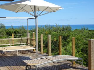 Governor's Harbour villa photo - Deck with teak daybed, teak lounge chair and umbrella overlooking the ocean