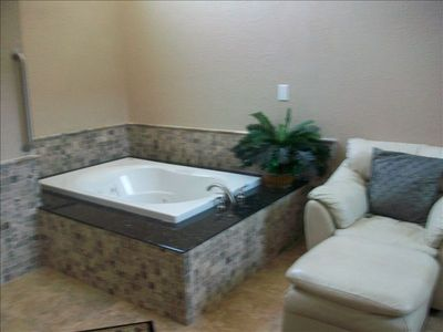 Whirlpool tub in master suite.