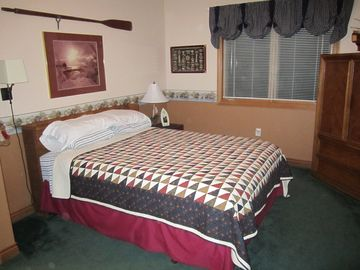 main floor bedroom with queen bed