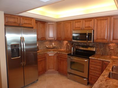 This kitchen has granite countertops, new appliances and recessed lighting!