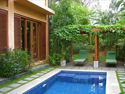 Private Plunge Pool with Built-in Bench, Surrounded by Lush Gardens.