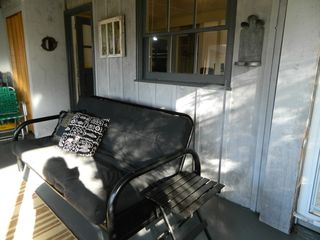 Montague cabin photo - The sunny porch offers a spot for a summer snooze.