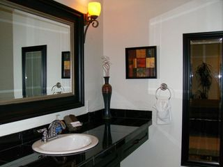 Another In Suite Bathroom with walk in Shower & Custom Vanity.