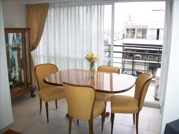 Dining room with fabulous view + beautiful decor