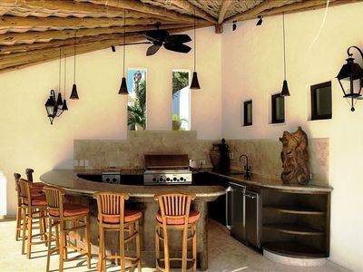 Palapa bar with BBQ/Burners, beverage center, ice maker, and sink