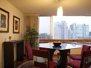 Lima condo photo - Formal Dining Area with city and ocean views, open the windows, hear the ocean!