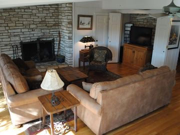 River-view Family Room with fireplace, large-screen HDTV and comfortable seating