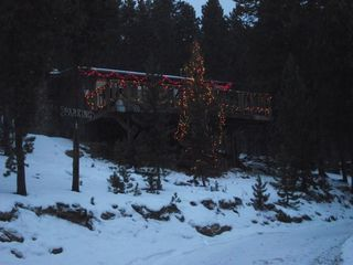Evergreen cottage photo - Guests from Florida Christmas 2012 Decorated the outside of Wilderness Cottage