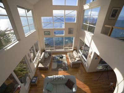 Great room featuring 27'  floor-to-ceiling windows and skylights
