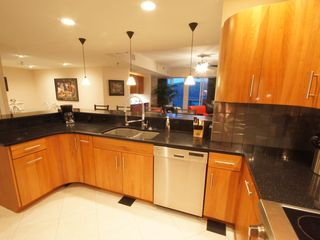 Osage Beach condo photo - The Kitchen is Fully-Equipped and Open to the Large Living Area