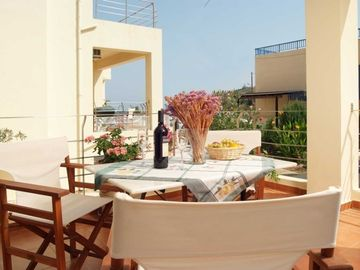 Spacious balcony with patio furniture