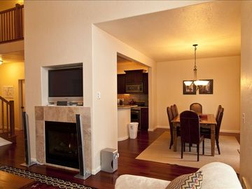 Living Room to dining area with two-way gas fireplace.