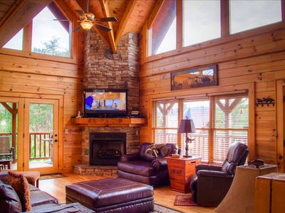 Decorative and comfortable great room with stone fireplace, LCD TV & BluRay DVD