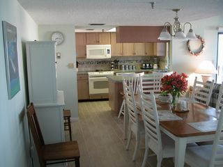 Redington Shores condo photo - kitchen and dining room (can seat 8) plus 2 at bar