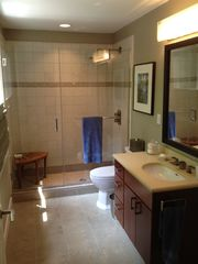 Bedford house photo - En-suite bath connected to first queen features a rain showerhead