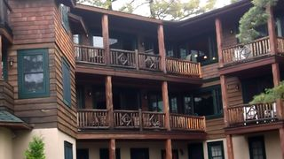 "Lake Placid property rental photo - Looking up to ""G"", located on top floor, from the beautiful grounds and lake."