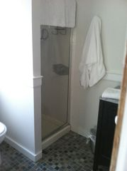Provincetown house photo - Second Floor Bath has a shower and tile floor. Plenty of clean white towels.