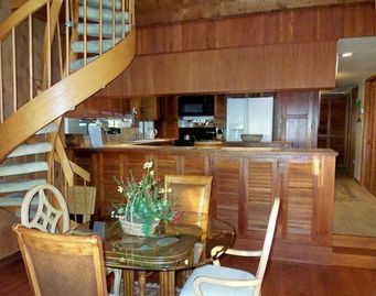 Dining area with loft spiral staircase