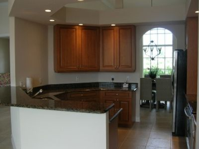 The kitchen features granite countertops and stainless steel appliances