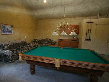 Game room with pool table and board games. Pool tournament, anyone?!