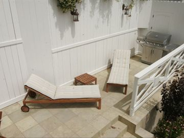 Chaise Lounge Chairs and Oversized BBQ- Perfect for Soaking up the sun & BBQ's