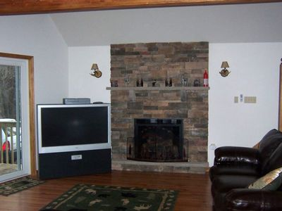 Sink Into The Leather Couch As You Relax By The Fire Watching The 50 Inch TV!!!!