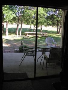 Covered back porch, large picnic tables for outdoor dining.