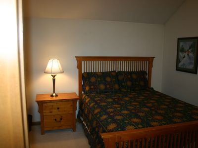 Upper level Queen bedroom has dresser and closet